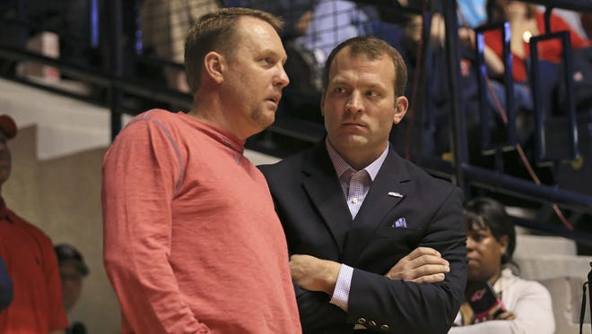 Hugh Freeze, left, has resigned as Ole Miss' coach
