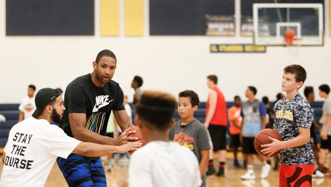 Grand Ledge alum and Boston Celtics big man Al Horford works on drills with kids Friday at Horford Hoop Plus Basketball Camp at Grand Ledge High School.
