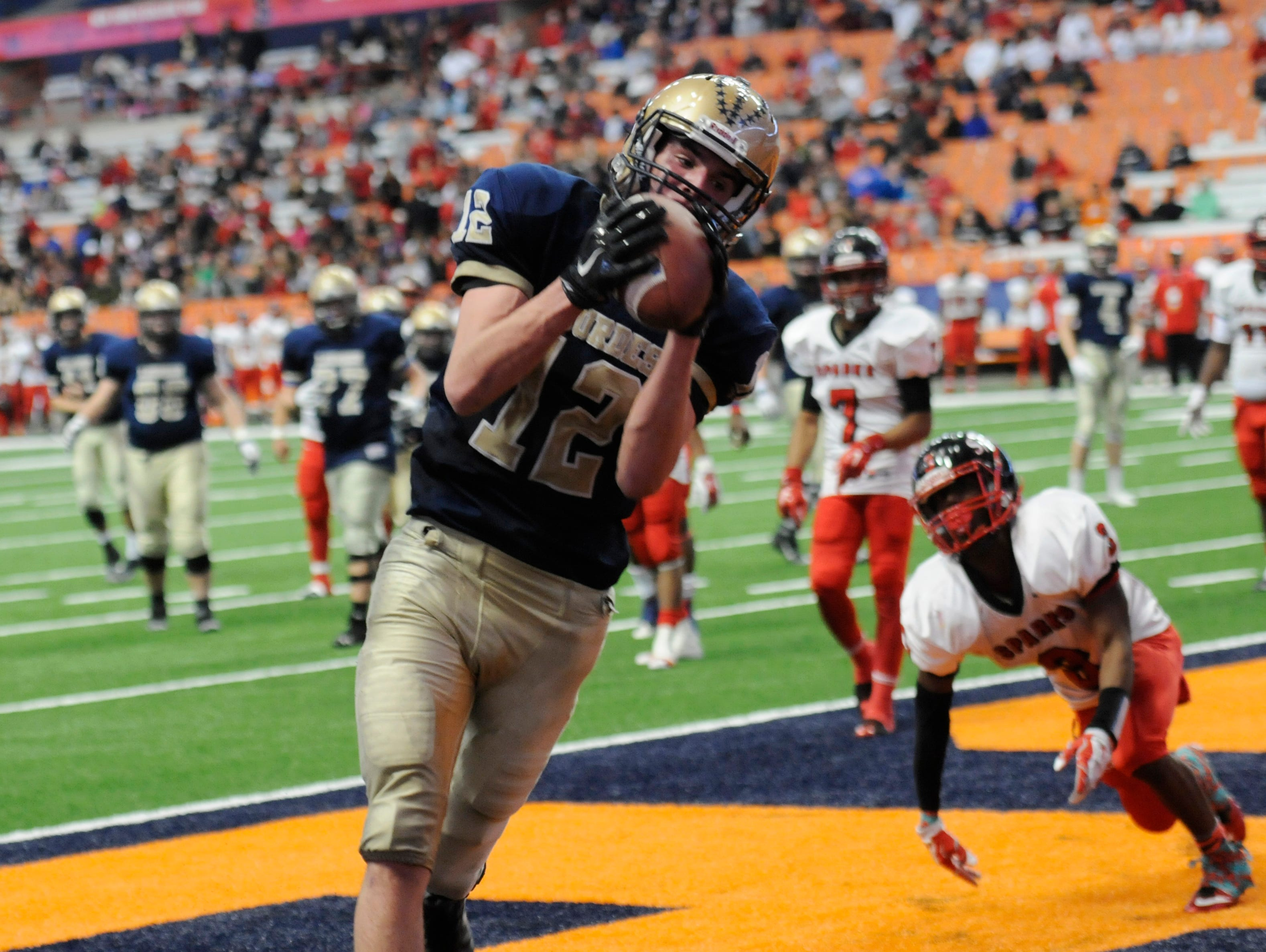 Lourdes' Luke Timm catches the ball for a touchdown during the New York State Championship final versus South Park in Syracuse on Friday.