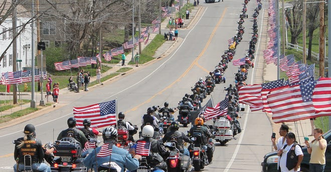 Members of the Rolla Patriot Guard Riders travel along the procession route on 10th Street in Rolla, Mo., after the funeral service of Sgt. Timothy Owens, 37, of Effingham, Ill., on April 12. Owens was a soldier killed in shootings at Fort Hood, Texas, this month.