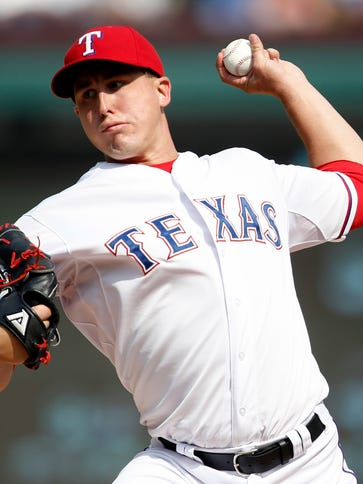 Rangers starting pitcher Derek Holland delivers a pitch