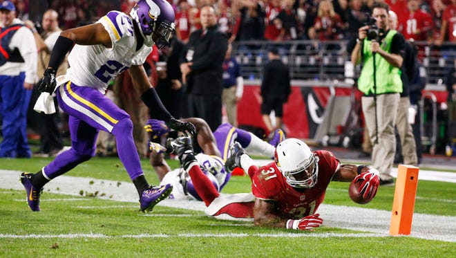 Arizona Cardinals running back David Johnson dives for the end zone but comes up 1-yard short against the Minnesota Vikings in the second half on Dec. 10, 2015 in Glendale, Ariz.