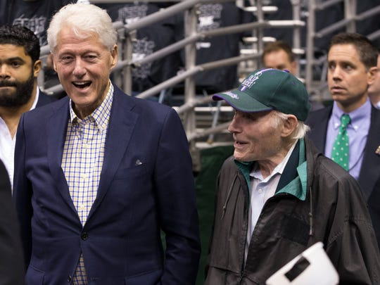 Former President Bill Clinton talks with former Milwaukee