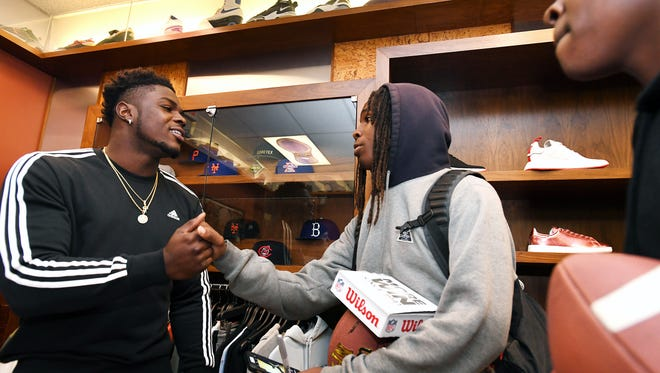 (left) Jabrill Peppers, former Paramus Catholic football star who will soon be drafted into the NFL, meets fans (center) Devin Manning, 14, and (right) Avonti Farrow, 16, at Packer Shoes in Teaneck on Saturday, April 22, 2017.