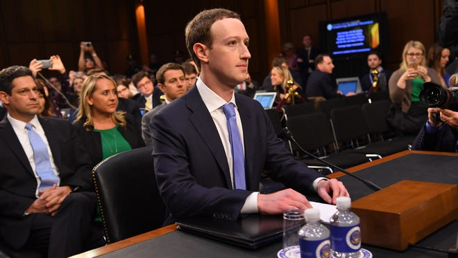 Facebook CEO Mark Zuckerberg arrives to testify before a joint hearing of the Senate Committee on the Judiciary and the Senate Committee on Commerce, Science, and Transportation regarding the company's use and protection of user data in Washington on April 10, 2018.