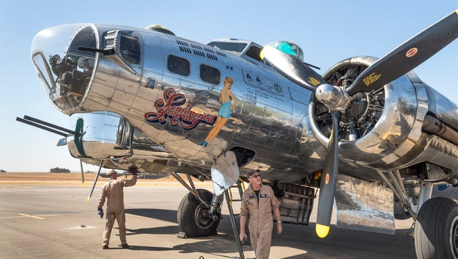 """Flight Load Master David Gilham, left, and pilot David Watson wipe down the B-17 Bomber """"Sentimental Journey"""", one of eight still flying today, after a flight on Monday, September 10, 2018. It will be on display at the Visalia Airport through Sunday."""