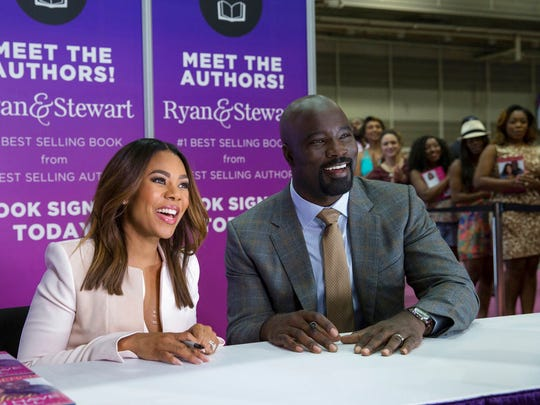 """Regina Hall, left, and Mike Colter in a scene from the comedy """"Girls Trip."""" The movie opens Thursday at Regal West Manchester Stadium 13, Frank Theatres Queensgate Stadium 13 and R/C Hanover Movies."""