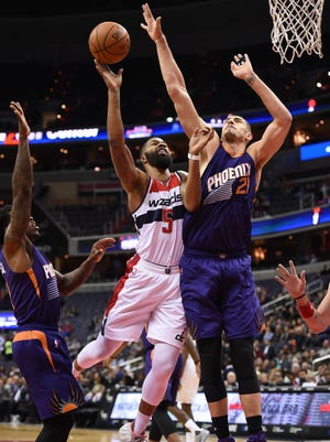Nov 21, 2016: Washington Wizards forward Markieff Morris (5) shoot in between Phoenix Suns center Alex Len (21) and  guard Eric Bledsoe (2) during the first quarter at Verizon Center.