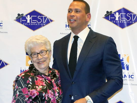 Martha Flores poses for a photo with Alex Rodriguez