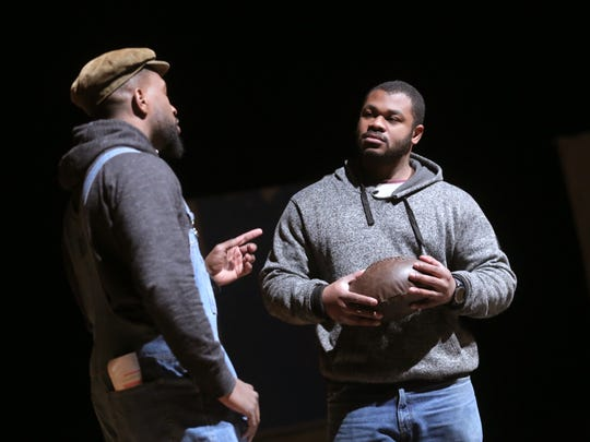 "Mike Barbosa, right, portrays Charles Follis and Damian Beauford portrays Charles' father  during a rehearsal ""The Black Cyclone"" at Mansfield Senior High School."