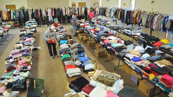 Volunteers put clothing in place for today's free clothing giveaway at St. Cloud Church of Christ in St. Cloud. The event will be held from 9 a.m.- 2 p.m.