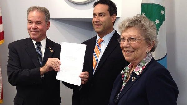 From left, In June, Rockland County Executive Ed Day, left, county Legislature Chairman Alden Wolfe and Legislator Harriet Cornell celebrated the water task force resolution in New City.