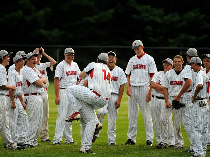 Oostburg celebrates with Chase Opgenorth jumping atop teammate Caleb Chaloupka after their baseball game against Kiel on Tuesday, July 15, 2014 at Kiel High School in Kiel. Oostburg won the game 9-6 in 8 innings. Matthew Apgar/HTR Media