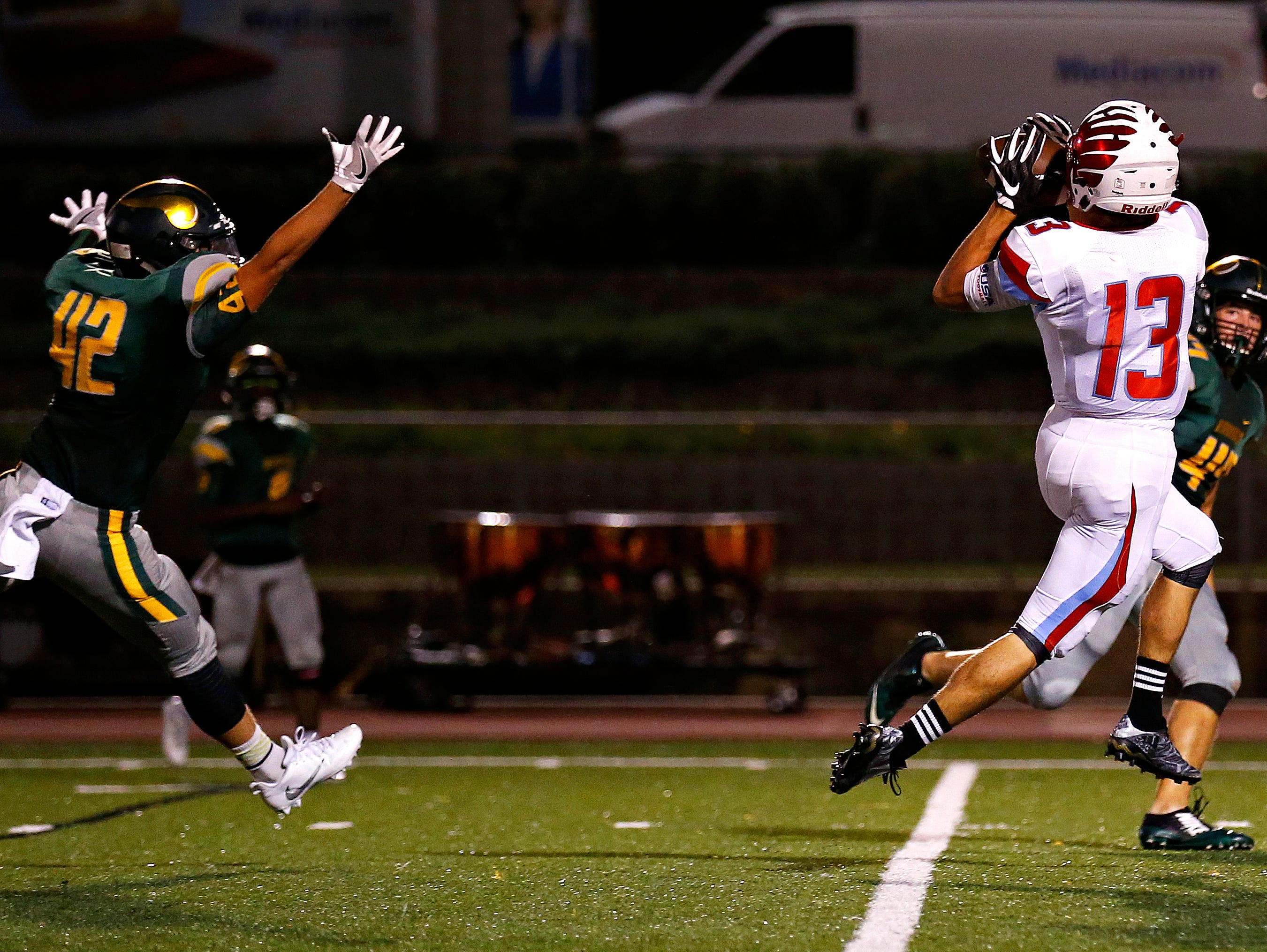 Glendale High School wide receiver Max Nichols (13) catches a long pass from quarterback Alex Houston (not pictured) for a touchdown during second quarter action of the football game between Glendale High School and Parkview High School at JFK Stadium in Springfield, Mo. on Sept. 22, 2016.
