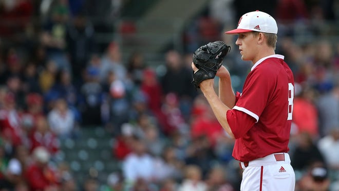 Indiana University pitcher Evan Bell gets set to fire a pitch during their NCAA game against Notre Dame at Victory Field in downtown Indianapolis on Tuesday, April 21, 2015. IU pulled out a 6-5 victory with three runs scored in the bottom of the ninth.