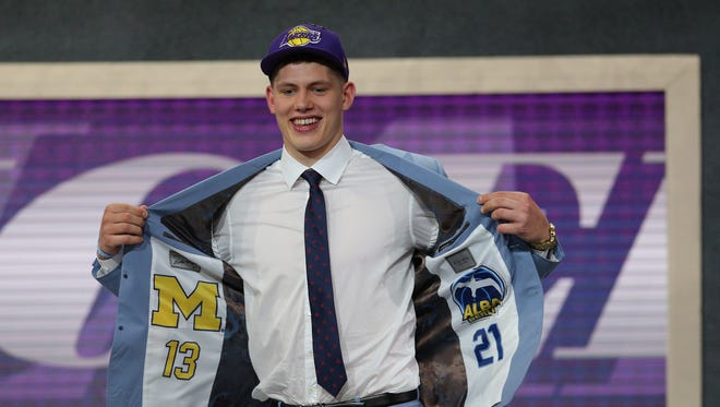 Michigan's Moritz Wagner reacts after being selected 25th overall by the Lakers on June 21.