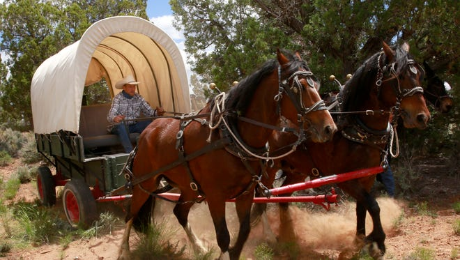 Aaron Zellmer of Durango, Colo., finds a place to camp with other members of a wagon train on Saturday off County Road 136 near Red Mesa, Colo.