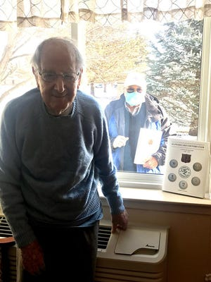 """Graydon Fox, author of the new book """"Klinger Lake Country Club's 100 Year History"""" is shown standing outside Harry Hunt's window at Thurston Woods in Sturgis."""