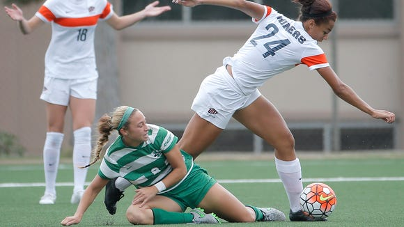 UTEP midfielder Aleah Davis battles Marshall's Ashley Seltzer during their match Sunday.