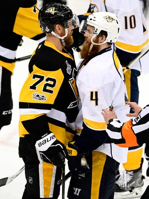 Nashville Predators defenseman Ryan Ellis (4) and Pittsburgh Penguins right wing Patric Hornqvist (72) get into a scuffle during the third period of game 2 in the Stanley Cup Final at PPG Paints Arena  Wednesday, May 31, 2017, in Pittsburgh, Pa.