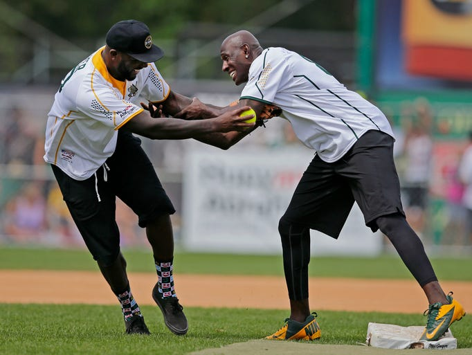 Is there holding in baseball? Donald Driver, right,
