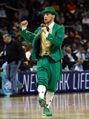 The Notre Dame Fighting Irish mascot performs during the first half of a second round game of the 2018 ACC tournament against the Virginia Tech Hokies at Barclays Center.