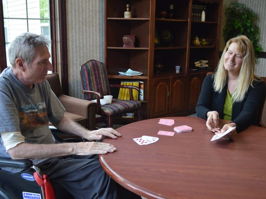 Tom Perszyk had to trade his baseball glove for playing cards and puzzle pieces because of ALS.