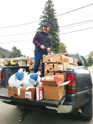 Lincoln County Food Bank volunteer Galen George helps prepare for distribution of 100 free turkeys to Food Bank clients Monday.