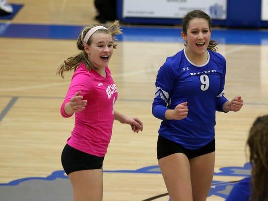 Barron Collier captains Lexie Hamilton, left, and Madison Campbell celebrate a kill during Thursday night's Class 7A regional semifinal against Fort Myers on their home court.
