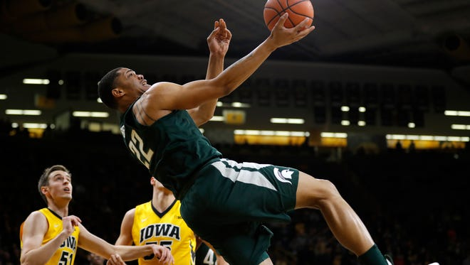Michigan State guard Miles Bridges (22) drives to the basket past Iowa forward Nicholas Baer, left, during the first half of an NCAA college basketball game Tuesday, Feb. 6, 2018, in Iowa City, Iowa.
