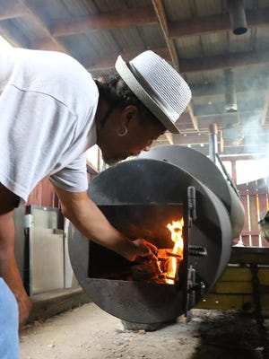 Spencer Phillips, AKA Daddy Moe, fires up his grill, Tuesday, July 21, 2020, to start cooking chicken breast, pork and beef ribs at Fort Smith's newest house of barbecue, Daddy Moe's, 1715 N. 13th St., behind the Martin Luther King Jr. Park. Open 11 a.m. to 7 p.m., Tuesday through Sunday, Daddy Moe's offers a menu ranging from barbecue beef and chicken to bratwurst, grilled quesadilla and wings.