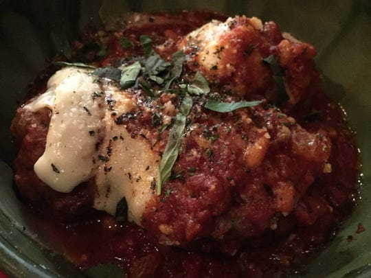 Mamas Neapolitan-style meatballs from Luca's Ristorante are homemade in-house-made meatballs made from short rib chuck and ground beef, pine nuts and golden raisins in organic tomato sauce and topped with provolone cheese.