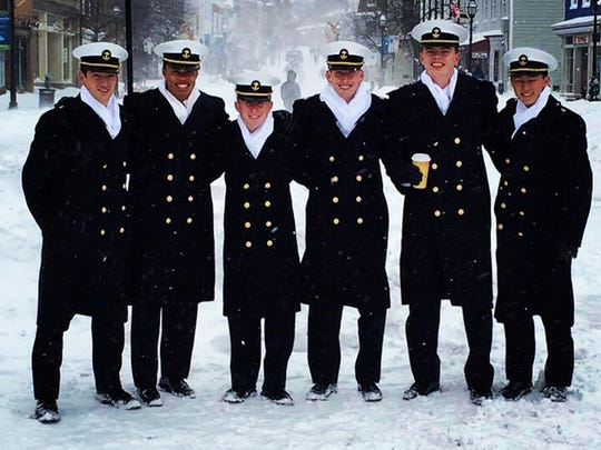 Gulf Coast High School graduate Justin Liberman, third from left, poses for a photo with fellow U.S. Naval Academy students.
