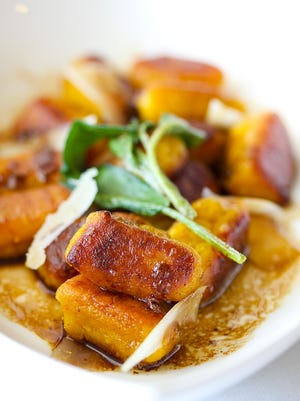 Pumpkin gnocchi with a brown butter sauce and crisp sage is one idea for a Thanksgiving side.