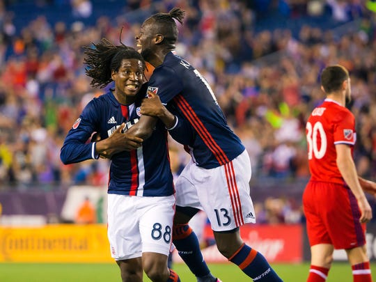 New England forward Femi Hollinger-Janzen (88) and forward Kei Kamara (13) celebrate a goal by Hollinger-Janzen during the second half of the Revolution's 2-0 win at Gillette Stadium.