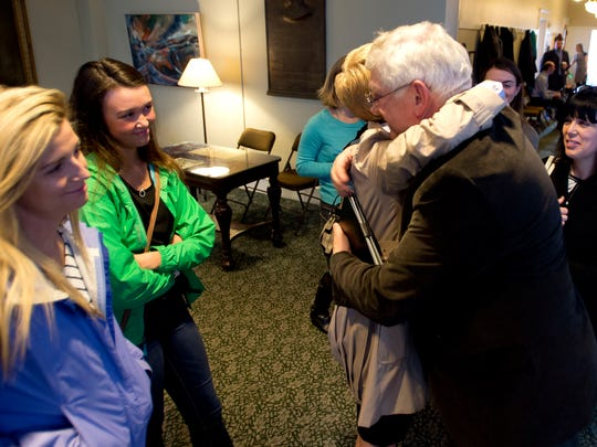 Rep. Ron Hubert, R-Milton, right, embraces Karen Preavy, Jordan Preavy's stepmother, as he talks with family members, from left, sisters Samantha and Taylor Paquette and Sierra Thompson, and Jordan's mother, Tracy Stopford, outside the House Judiciary Committee at the Statehouse in Montpelier on Tuesday.