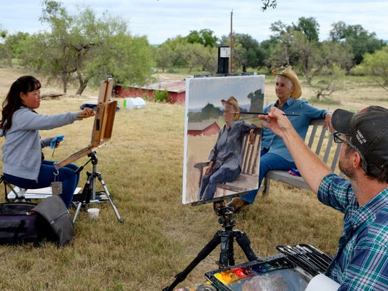 Hiu Lai Chong of Maryland and John Lasater of Arizona paint Judy Sikes at a ranch during the 2016 EnPleinAirTEXAS.