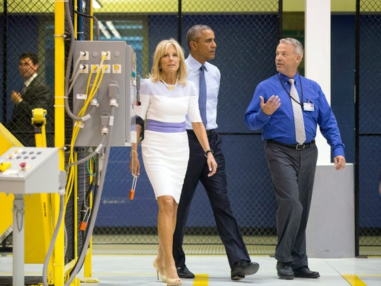 President Barack Obama, accompanied by Jill Biden, tours the Michigan Technical Education Center with Holger Ekanger, director of M-TEC Workforce and Continuing Education, Engineering & Advanced Technology at Macomb Community College, in Warren, Mich., on Wednesday.