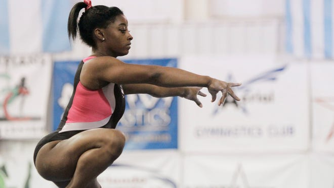 Simone Biles, working out at the Karolyi ranch in 2015, says the idea of returning there to prepare for the 2020 Olympics is difficult.