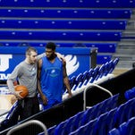 FGCU Basketball players Brett Comer and Jamail Jones confer during a practice at Alico Arena on Monday 3/2/2015.  The team is preparing for the Atlantic Sun Conference tournament quarterfinal.