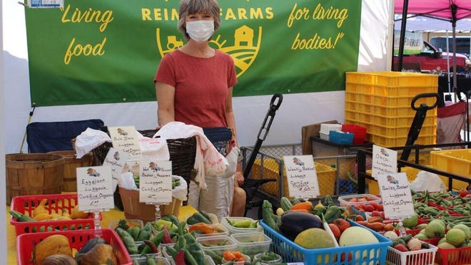 Lisa Reimer manages her booth of produce at the Lubbock Downtown Farmers Market on Sept. 26.