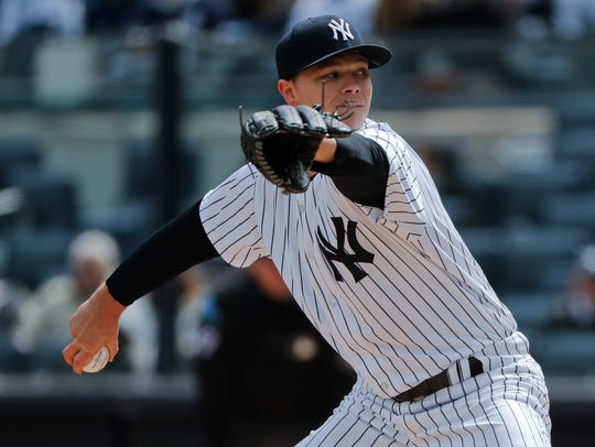 New York Yankees pitcher Sonny Gray delivers against