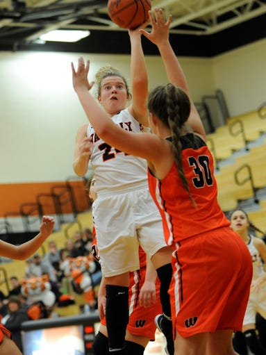 Waverly point guard Zoiee Smith scores during the first