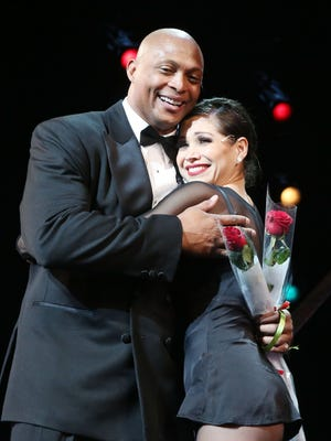 """Eddie George and co-star Bianca Marroquin during his curtain call on opening night for """"Chicago"""" at The Ambassador Theater in New York City."""