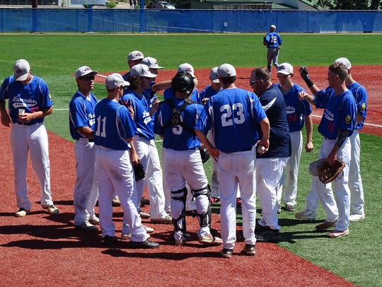 Members of the Post 11 baseball team huddle before