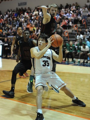Raider sophomore guard Benito Munoz drives into the basket Friday night at Harrison.