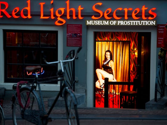 A hologram of a beckoning prostitute is shown at the entrance of the 'Red Light Secrets' museum in Amsterdam on Feb. 4, 2014.