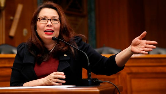 Sen. Tammy Duckworth, D-Ill., speaks on Capitol Hill in Washington, D.C., on Feb. 14, 2018.