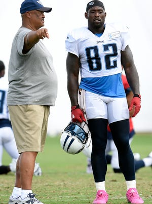 Titans offensive coordinator Terry Robiskie talks with tight end Delanie Walker (82) during practice at St. Thomas Sports Park Wednesday Aug. 10, 2016, in Hendersonville, Tenn.
