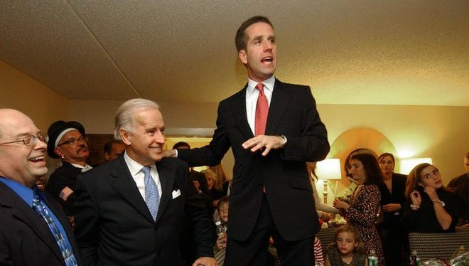 After winning the attorney general race in 2006, Beau Biden makes his acceptance speech with his father, Joe Biden, in his room at a Wilmington hotel on Nov. 7, 2006.
